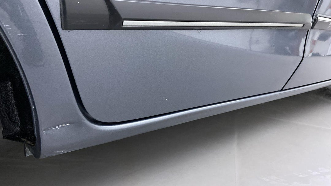 Right Rocker Panel Dent (1 to 2 inches)
