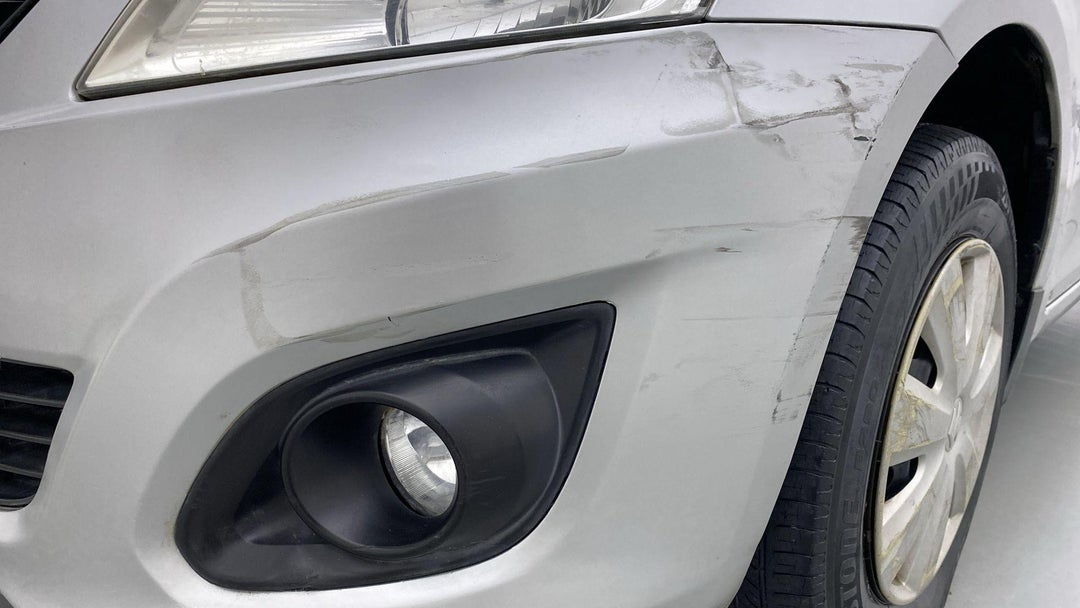 FRONT BUMPER MULTIPLE SCRATCHES (2 TO 3 INCHES)