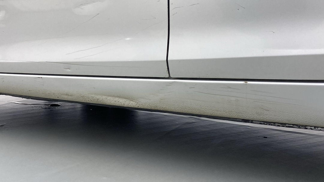 LEFT ROCKER PANEL DENT (4 TO 5 INCHES)