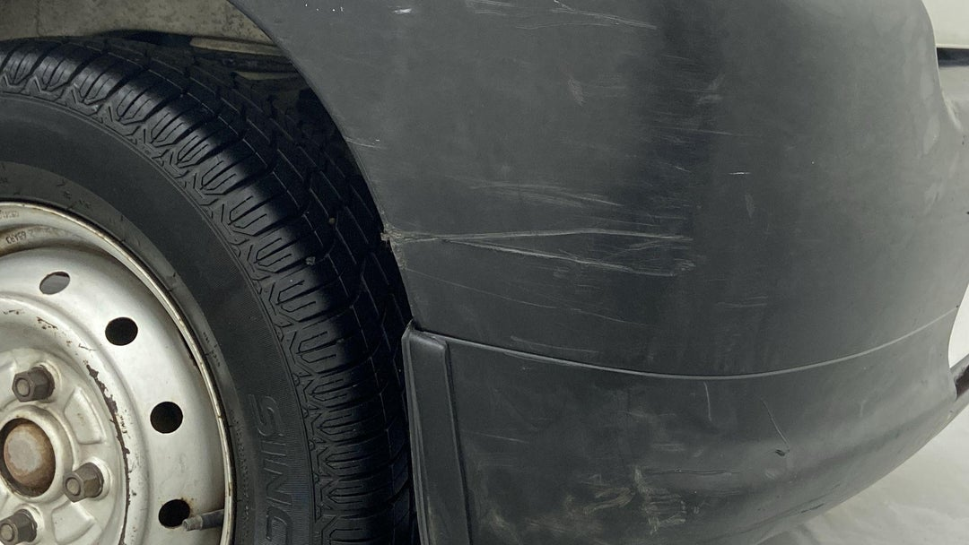 REAR BUMPER MULTIPLE SCRATCHES (3 TO 4 INCHES)