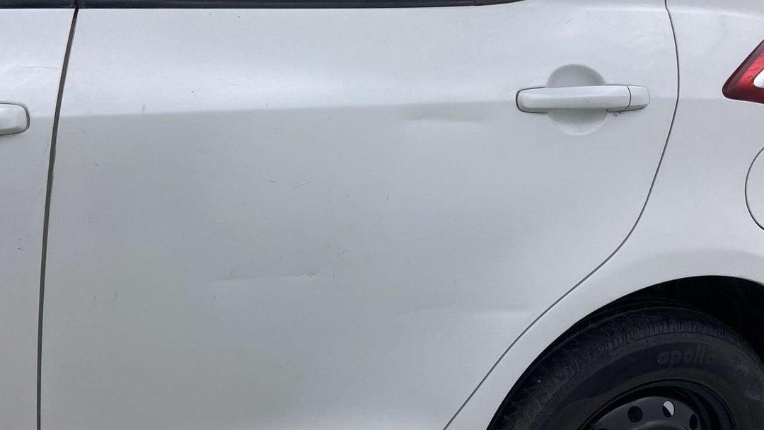 Left Rear Door Dent (3 to 4 inches)
