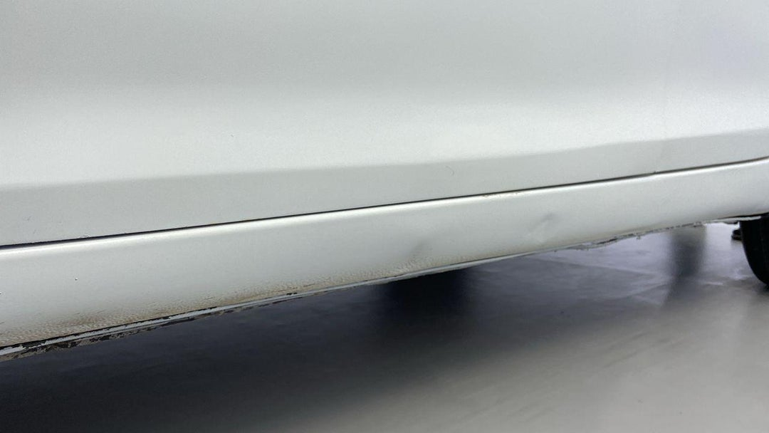 Left Rocker Panel Dent (1 to 3 inches)