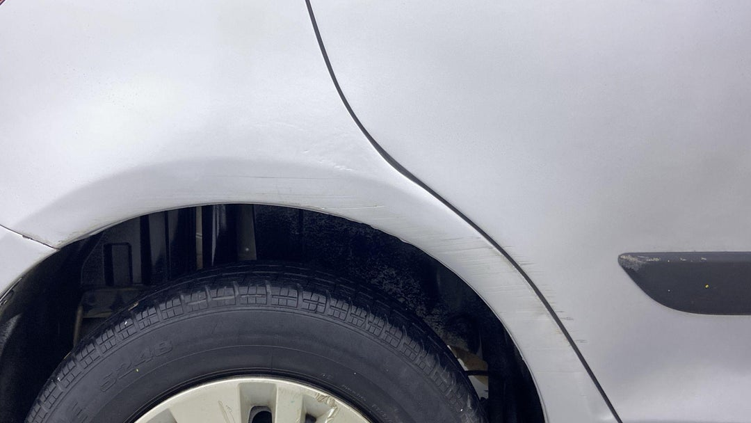 RIGHT QTR PANEL SCRATCHED (3 TO 4 INCHES)