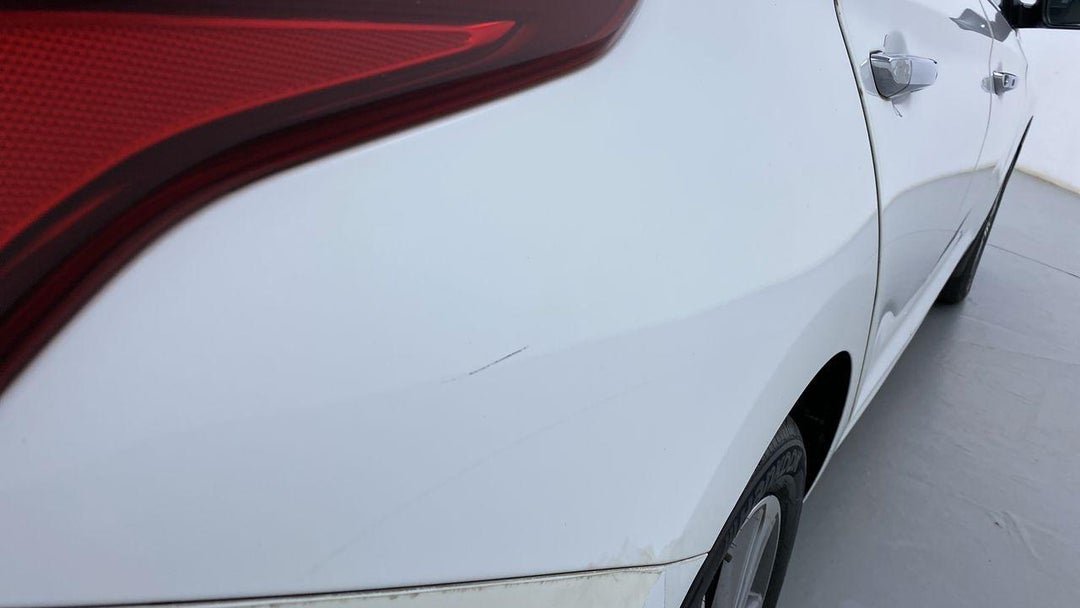 RIGHT QTR PANEL LIGHT SCRATCH (1/2 TO 1 INCH)
