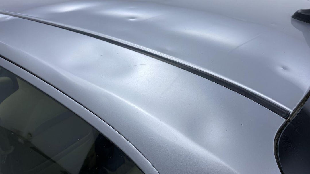 Roof Multiple Dents/No Paint Damage (PDR-13 to 15 dents)