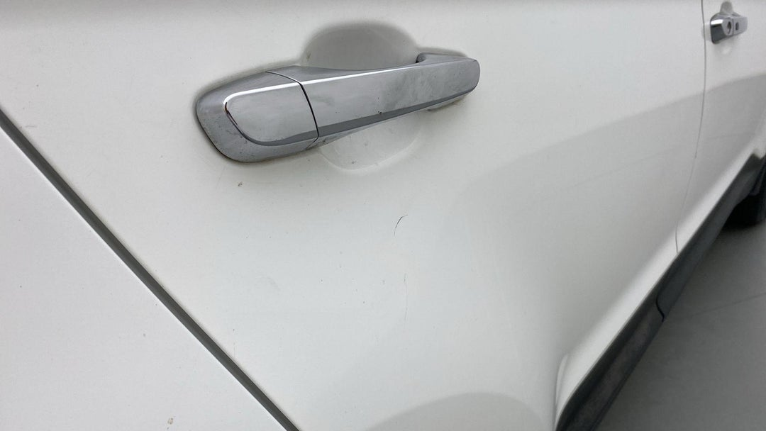 RIGHT REAR DOOR LIGHT SCRATCH (2 TO 3 INCHES)