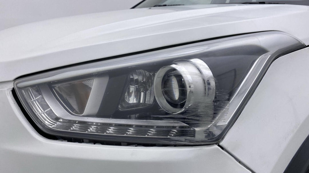 LEFT HEAD LAMP SCRATCHED