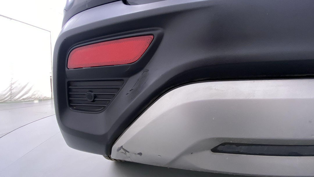 LEFT REAR BUMPER/COVER HEAVY SCRATCH (3 TO 4 INCHES)