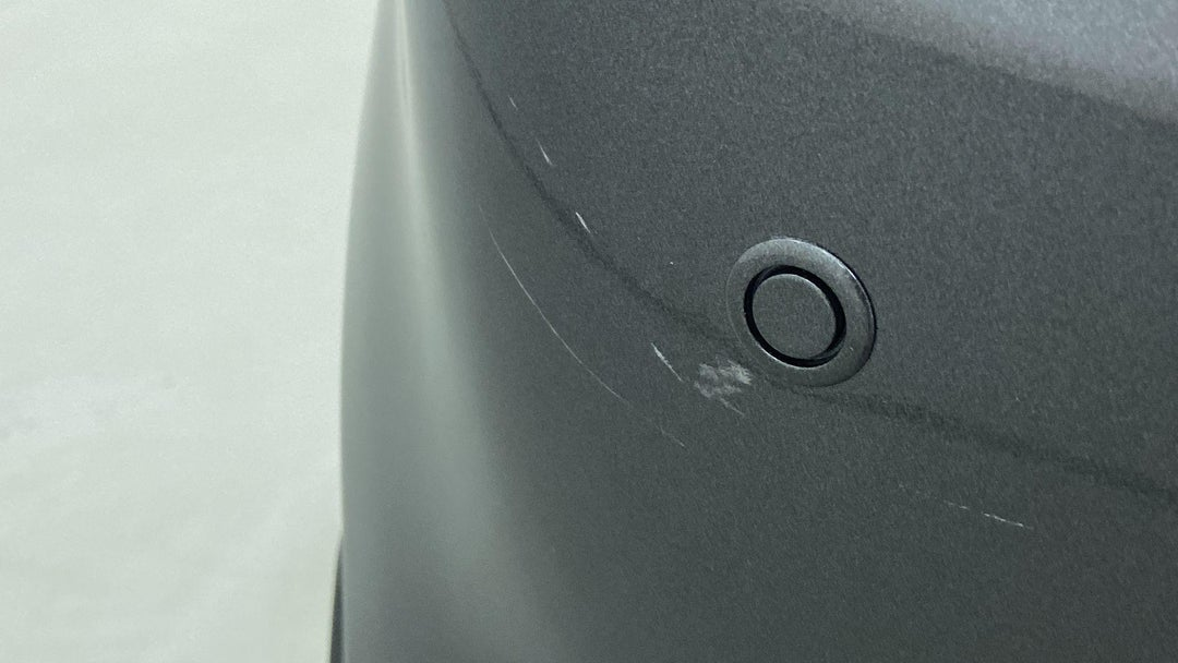 LEFT REAR BUMPER/COVER HEAVY SCRATCH (1 TO 3 INCHES)