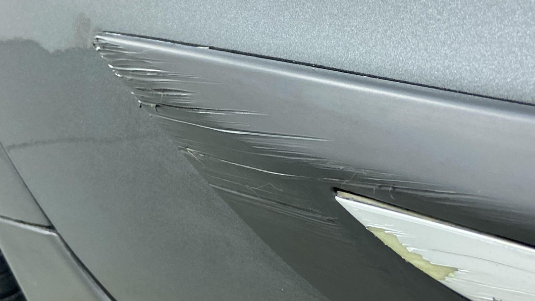 RIGHT REAR DOOR MULTIPLE SCRATCHES HEAVY (1 TO 3 INCHES)