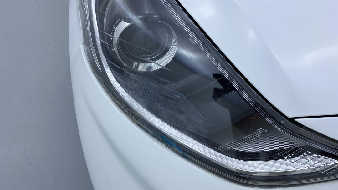 RIGHT HEAD LAMP SCRATCHED