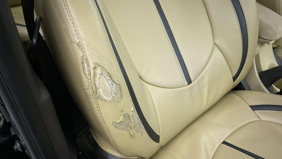 Right Front Seat Torn (3 to 4 inches)
