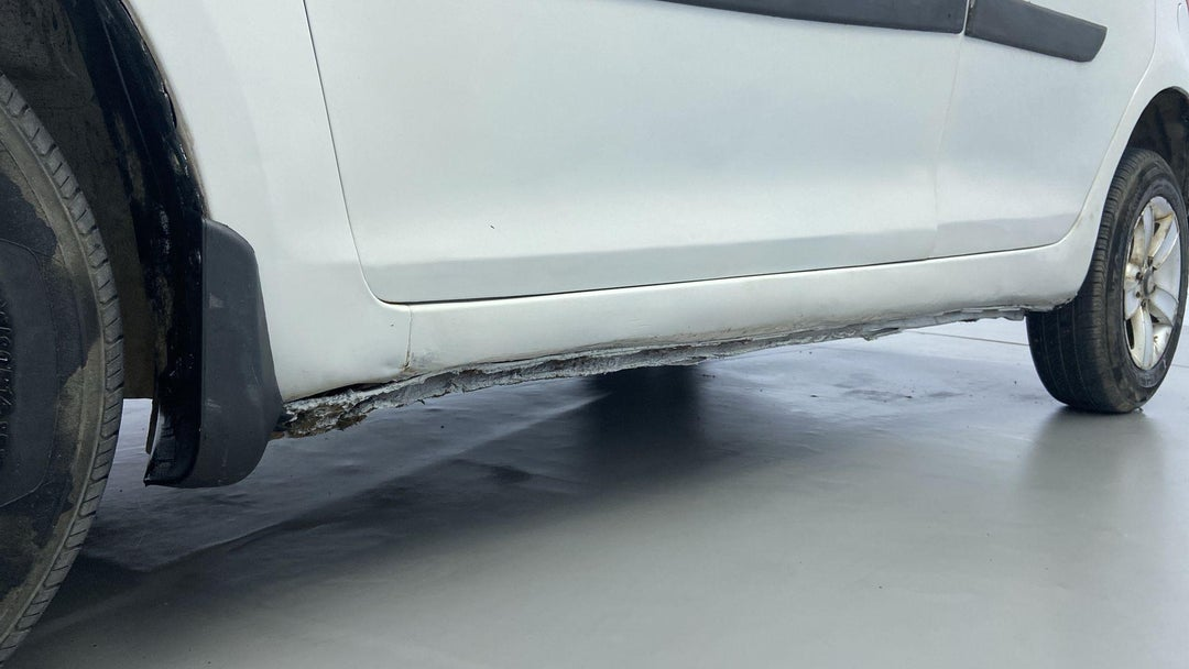 LEFT ROCKER PANEL RUST (6 TO 9 INCHES)