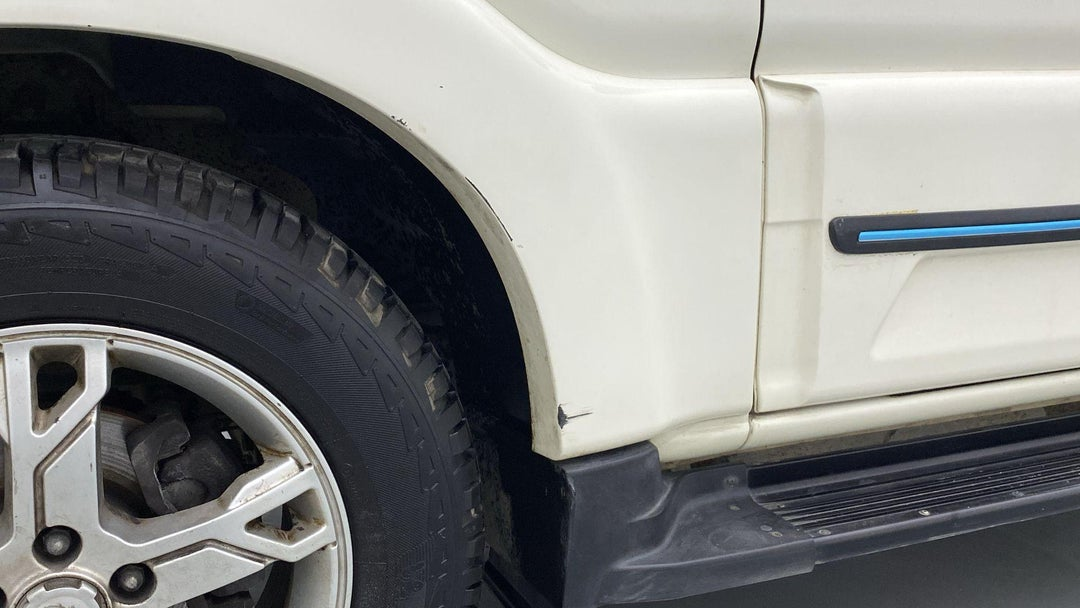 LEFT FRONT FENDER SCRATCHES (3 TO 4 INCHES)