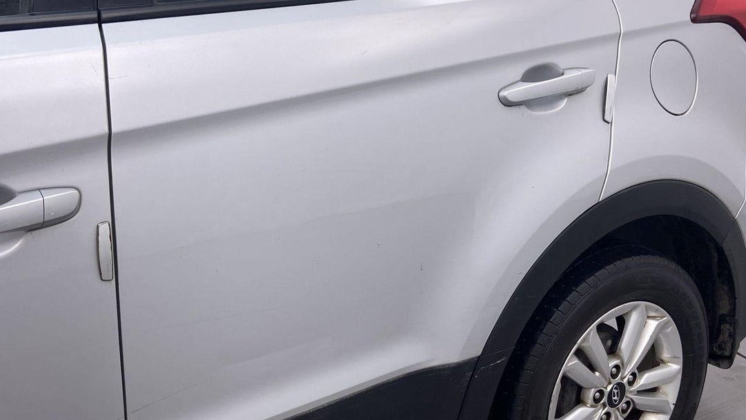 Left Rear Door Edge Scratched (1 to 2 inches)