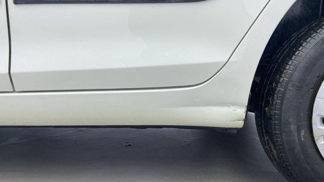 Left Rocker Panel Dent (6 to 7 inches)