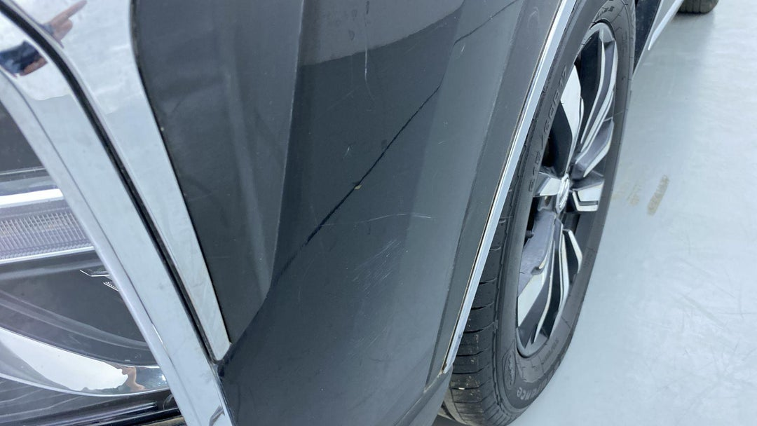 FRONT LEFT BUMPER/COVER SCRATCHED
