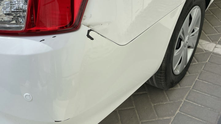 Nissan Sunny-Right Rear Bumper/Cover Dent(s) W/ Paint Dmg (3 to 4 inches)