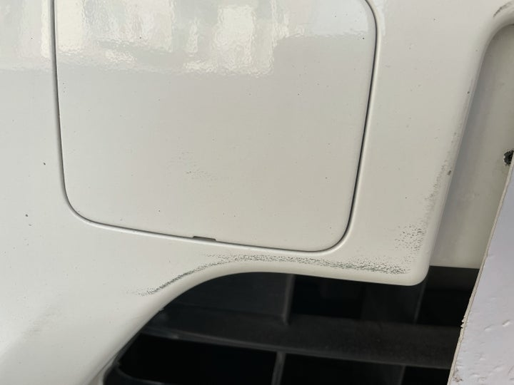 Nissan Sunny-Front Bumper Light Scratch (1 to 3 inches)