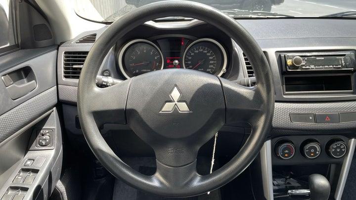 Mitsubishi Lancer-STEERING WHEEL CLOSE-UP