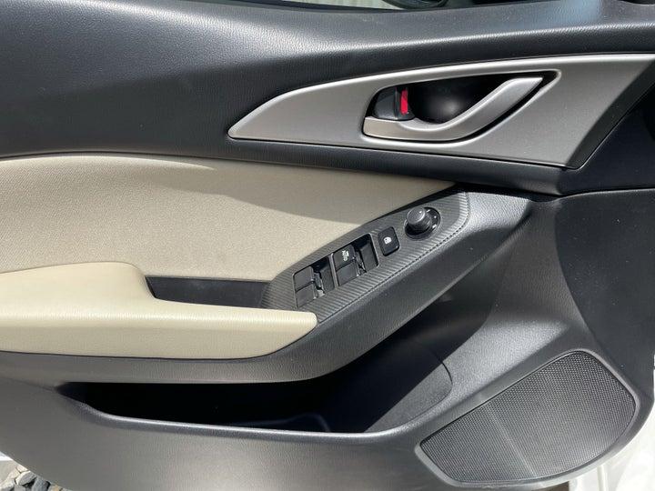 Mazda 3-DRIVER SIDE DOOR PANEL CONTROLS